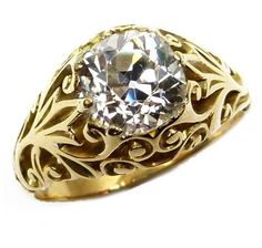 Antique single stone cushion diamond and gold ring, c.1895, the claw set stone to a pierced foliate scroll mount, plain shank