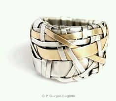 Stacked bangles interwoven with different fabric