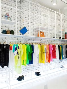 Sumit Shop by m4 design (Seoul) lets the clothes do the talking. With simple but unique white brick walls and pipe displays, clothing and accessories make the design unique. #Design #Retail