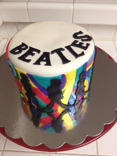 Beatles Cake inspired by the iconic walking pose & the cover art of the Yellow Submarine Album!    One Tier, Red Velvet & Cream Cheese Frosted Cake.    Uploaded by Kaili on Saturday Jun 02 10:00:42 2012  Submitted into the June, 2012  Inkedibles Contest