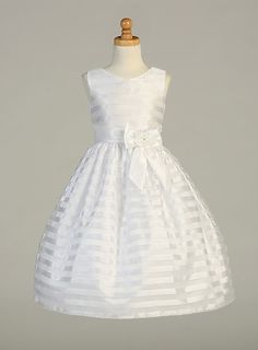 An exquisite style that can be worn event after event. This striped organza dress has a taffeta waistband and bow accent. Dress is perfect for any Flower Girl or First Holy Communion. Dress offered only in White. This dress is seasonal, so if you are thinking of this dress, we advise that you may want to plan accordingly for the upcoming event. Take a look at the large pictures of this dress so that you can appreciate the fabric and exquisite workmanship on this dress. Dress is fully lined…