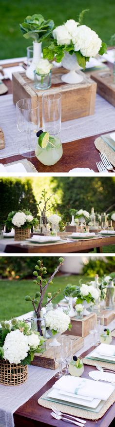 contemporary farmhouse: wood farmhouse table with benches and crisp contemporary white seat cushions...cheese cloth as a table runner...modern stemware along with rustic woven place mats, milk glass containers and overturned rustic crates.