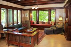 Stately craftsman-style mini-mansion w/ orig. rich mahogany stained gumwood pillars, partitions, and mouldings*Parlor w/ tooled leather walls*frml liv… Craftsman Living Rooms, Craftsman Decor, Craftsman Interior, Craftsman Style Homes, Craftsman Bungalows, Arts And Crafts Interiors, Mission Furniture, Timber Walls, Bungalow Homes