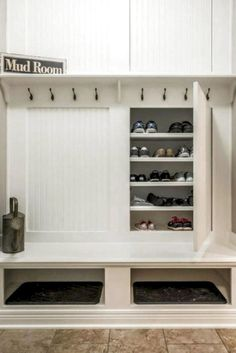 Custom mudroom storage with concealed shoe storage, 8 hooks for coats and two large cubbies. 8 Fun and Functional Mudroom Ideas for a Super-Organized Your Home Storage Entryway Laundry Shelves, Mudroom Laundry Room, Laundry Room Design, Closet Mudroom, Shoe Storage Laundry Room, Garage Closet, Mud Room In Garage, Front Closet, Porch To Mudroom
