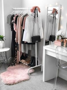 My wardrobe + beauty room. Makeup vanity from Ikea (Malm dressing table), Target chair, Kmart rug, Ikea clothing rack, Kmart side table || Find me on Pinterest @flipandstyle or visit my blog www.flipandstyle.com