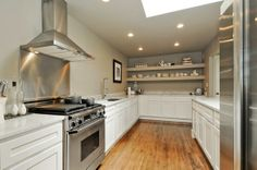 AFTER: Open, airy, remodeled Kitchen with carrera modrble countertops, salvaged wood floors #realestate #forsale #home