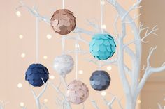 Baubles don't have to be bought to look classy - I had a go at making some very simple ones using a paper punch and some thick paper/card, and they turned out a dream!