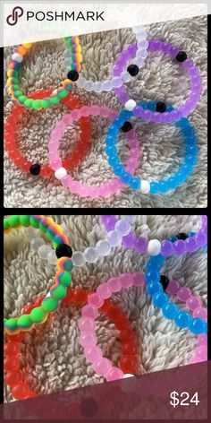 """6 bundle Transparent Silicone Beaded Bracelets Transparent Silicone Bead Bracelets. Just want to get rid of these. If you don't like the bundle price make me an offer.   6 Bundle is size Med 6.5""""  -Clear -Blue -Red -Pink -Purple -Neon  My wrist is 7"""" w/ biggest part of hand abt 8.5"""" - 9"""" so once it goes past my hand to my wrist the fit is fitted with room to move not tight. Jewelry Bracelets"""