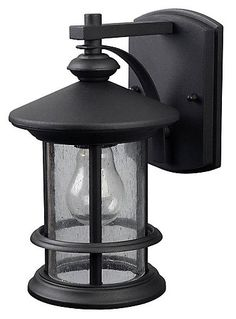 The RYDER Collection of outdoor lighting features a classic black finish paired with seeded glass. This single light wall lantern will fit perfectly in any outdoor space.