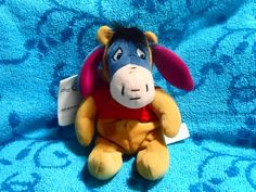 Eeyore wearing Pooh costume (I have this one)