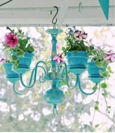 Transform a junk shop chandelier into a lovely Terracotta Planter Chandelier.  It's a great repurpose you'll enjoy. Be sure to also view the Claypot People and Lighthouses.                                                                                                                                                      More