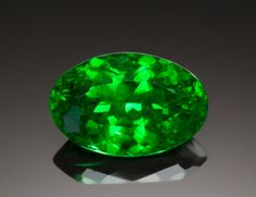 TSAVORITE - 5.64 CT.  Scorpion Mine, Tsavo National Park, Voi, Taita Taveta District, Coast Province, Kenya    In 1967, in what is now known as Tanzania, British geologist Campbell Bridges discovered, bright green Grossularite: Tsavorite.  Tsavorite has a particularly high refractive index and does not have to undergo any treatment to bring out its color - resulting in natural green gemstones of great brilliance