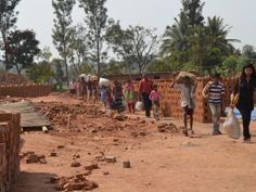 An IJM Bangalore lawyer leads the families out of the brick factory // #humantrafficking