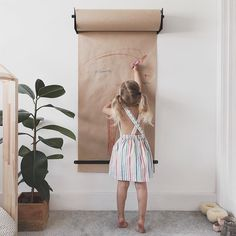 Give her a roll of paper bigger than her and she still manages to draw on the walls . 'That's ok Mammy isn't it?' if it keeps her occupied for longer than five minutes then yes. Draw away little one. Studio Roller by @georgeandwilly