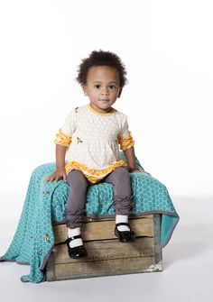 Kickee Pants debuts with Discovering Life: six collections for fall 2015 that showcase the natural world as seen through a child's eyes. The groups of cotton knit stroller blankets, socks and apparel are colored in a soft, sophisticated palette of lotus (dusty pink), natural, peacock, fuzzy bee (gold), willow (light, dusty green) and feather (pale gray). Bee-ware, you're about to fall for the Long Sleeve Baby Doll Dress and Legging Set in Honeycomb. www.kickeepants.com (designer preview)