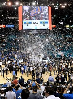 Confetti and balloons rain down on the court as UCLA celebrates its 75-71 Pac-12 tournament title victory over Arizona at the MGM Garden Arena in Las Vegas on Saturday.