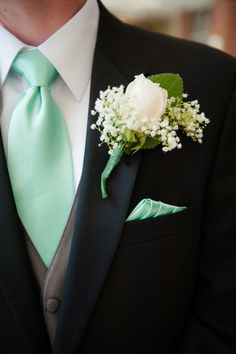 Teal tie & babys breath boutonniere from Chris & Vidas beautifully simplistic, teal & sea foam green, springtime wedding in Northern Virginia. Images by Kelly Ewell Photography.