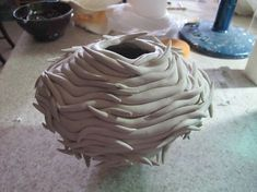 This piece first caught my eye because it sort of looks like a beehive. It is very well constructed and appears very simple to make, but complex at the same time.
