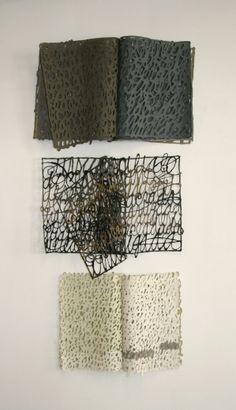 Miriam Londono (Calligraphy done with paper pulp make up these...)