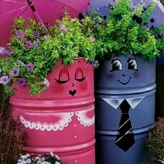Cute flower planters! Large metal cans painted, flowers inserted and cute pink and blue umbrellas added for that extra touch! Adorable!!