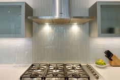 """cook-top waterfall feature created using Opera Glass in """"Slivers solo"""" by Artistic Tile"""