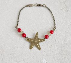 Seastar bracelet brass & red bamboo coral by PetiteFraise on Etsy #handmade #jewelry #seaside #beach #summer #sea #creatures #boho #chic #tropical #fashion #style #starfish #coralreef #nautical