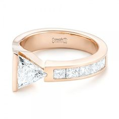 This stunning engagement ring features a trillion diamond asymmetrically bar set, with channel set princess cut diamond accents along the top of the rose gold band. Designed and created by Joseph Jewelry Three Stone Engagement Rings, Diamond Engagement Rings, Trillion Engagement Ring, Solitaire Rings, Bijoux Or Rose, Stacked Wedding Rings, Finger, Pear Shaped Diamond, White Gold Rings