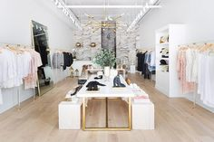 """Anne had a clear vision in mind when she approached the store's design. """"I wanted the clothing to shine and take center stage,"""" she said. """"I envisioned the space acting as a beautiful..."""