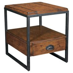 Industrial-inspired cocktail table with a lower shelf.    Product: Side tableConstruction Material: Wood...