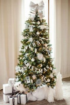 """For The Wordsmith - Bring in some word play by repurposing paper party garlands into ornaments—turning messages of """"Merry Christmas"""" and """"Happy Holidays"""" into focal points for a wonderfully wordy tree."""