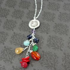 Om Chakra Necklace-Total Balance. A specific gemstone intentionally selected for each chakra. As always, each piece of jewelry is lovingly infused with Reiki!