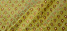 This Blonde yellow Benares Kora Saree has silver,canary yellow and hot pink thread work.The pallu is in Apple red with multi colour thread work making it more beautiful.It comes with apple red blou…