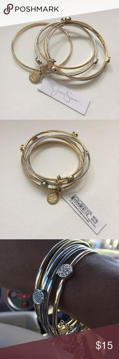 🆕 Jessica Simpson Silver and Gold Bangle Set Brand new! Gold and silver tone 5 piece bangle set. Can wear them all or only a few. It's up to you! Please no holds, trades, or pp. Thank you! Jessica Simpson Jewelry Bracelets