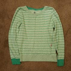 """NWOT Volcom Stone Sweatshirt NWOT Teal striped Volcom Stone Sweatshirt. Size Large. Has a front pocket. To the left of the pocket is the volcom logo in hot pink. 25"""" sleeve. Perfect with jeans. Free of stains and blemishes. No trades. Volcom Tops Sweatshirts & Hoodies"""