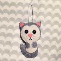 A personal favorite from my Etsy shop https://www.etsy.com/listing/222094786/handmade-felt-cat-ornament-grey