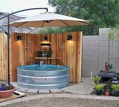 stock tank makes a cool little pool add a saltwater filter, waterfall and tons of shade, plus light for nighttime. Much better than a plastic kiddie pool. Round Stock Tank, Stock Tank Pool, Outdoor Fun, Outdoor Spaces, Outdoor Living, Outdoor Decor, Rustic Outdoor, Outdoor Ideas, Backyard Projects