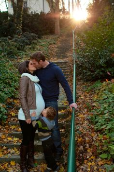 beautiful fall family maternity photo... love the sibling kissing the belly