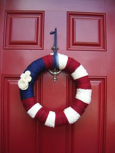 Vintage Americana yarn wrapped wreath with felted flowers. LOVE