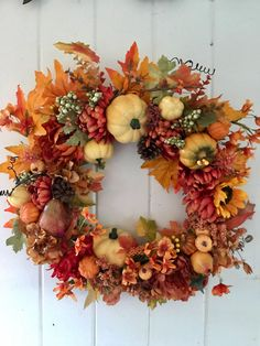 A personal favorite from my Etsy shop https://www.etsy.com/listing/540422323/fall-wreath-front-door-wreath-pumpkin