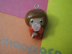 This cute one-of-a-kind chibi girl (holding a pink rose) charm is made out of cold porcelain (air-dry) clay. It is glazed to a shiny finish with Triple Thick Gloss Glaze.    This adorable charm can be used as a phone charm or even on a necklace or bracelet. However, because it is delicate, please...