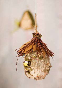 Cute idea for rustic party decor — hanging wooden birds' nests