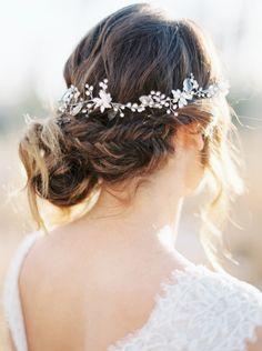 Fishtail braid with dainty hair accessories