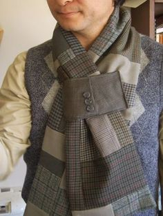 After a spate of jacket surgery I found myself left with a bag full of jacket arms. What to do with them? Answer:Cozy patchworked wool scarves. I attached a cuff to each of the scarves so that one end can be threaded through it to stop the scarf from fall