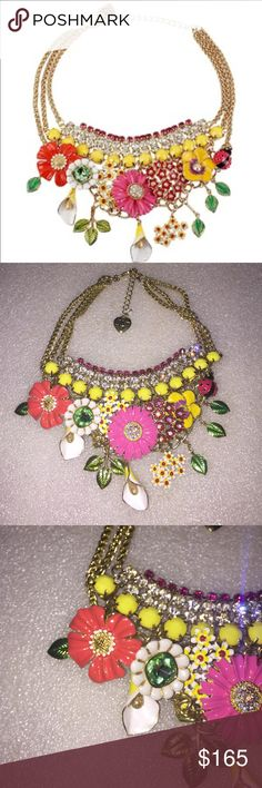 Betsey Johnson necklace Selling to buy Betsey pieces I need. This is from the spring collection. The necklace is gold tone. The charms include lots of flowers of various sizes and shapes, with strands of rhinestones in the center. NWT Betsey Johnson Jewelry Necklaces