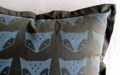 Grey scatter cushion with oxford borders and hand-printed fox faces in blue-grey