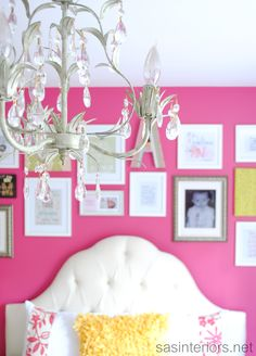 Big Girl Bedroom via sasinteriors.net. Bold wall color with white tufted headboard.