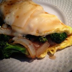 """Broccoli, roasted garlic, and onion omelet with Swiss cheese and a little maple bourbon glaze. #bittermommy #boozybreakfast #bourbon #cookingwithbooze…"""