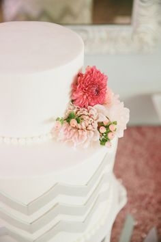 White and Gray Chevron Wedding Cake with Blush and Pink Flowers | Onelove Photography | See More! http://heyweddinglady.com/pink-mint-and-gold-wedding-with-lots-of-sparkle/