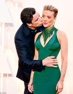 Sneak attack: Actor John Travolta, who fluffed Frozen singer Idina Menzel's name at last y...