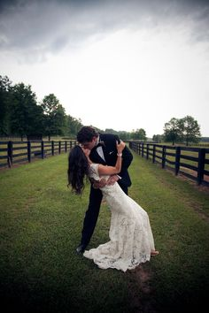 Beautiful outdoor setting for elegant southern wedding at Fox Hall Resort and Sporting Club   Sweeping kiss on the polo grounds    Photography by JWKPEC Photography   GRO Floral and Event Design   Southern Charmed: Caroline and Alex